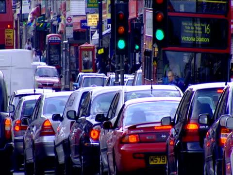 Cars wait at traffic lights in traffic jam London