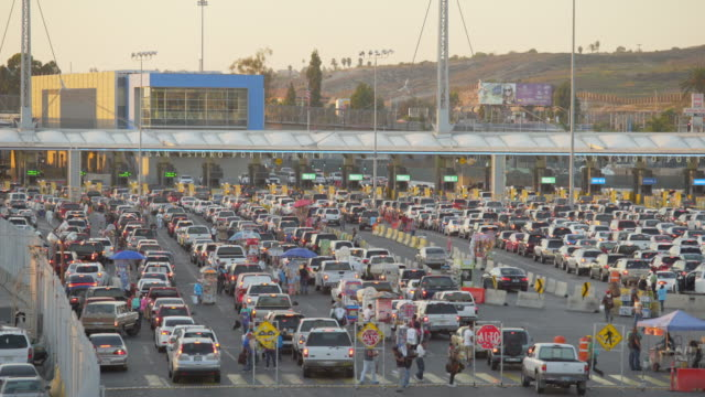 cars waiting at the us-mexico border - national border stock videos & royalty-free footage