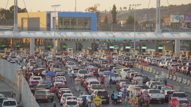 cars waiting at the us-mexico border - geographical border stock videos & royalty-free footage