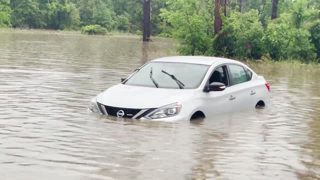 cars were submerged in floodwater past their tires after heavy rains drenched lake charles, louisiana, on may 17, video shows. louisiana resident... - drenched stock videos & royalty-free footage