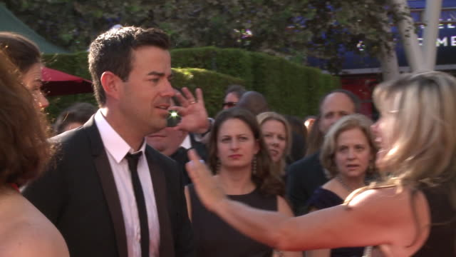 MS Carson Daly and Siri Pinter moving through crowd on the red carpet stopping briefly to greet unidentified woman before walking over to reporters...
