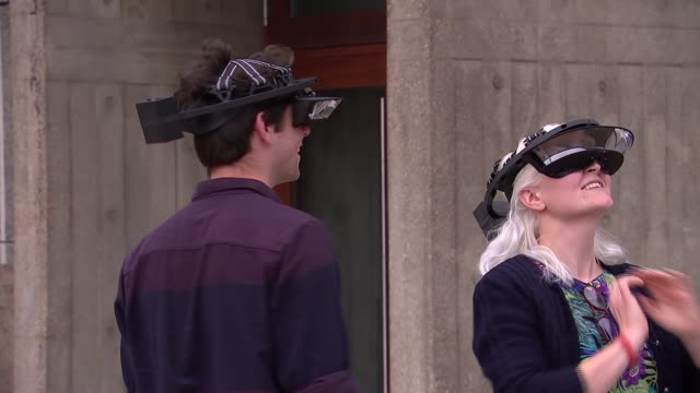 carsten holler 'decision' exhibition at the hayward gallery ext woman and man wearing headsets as part of installation / various shots of isomeric... - hang gliding stock videos and b-roll footage