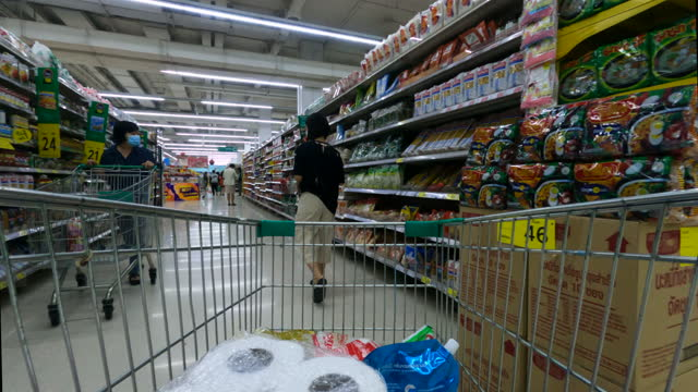 cart is rolling around the supermarket - market retail space stock videos & royalty-free footage