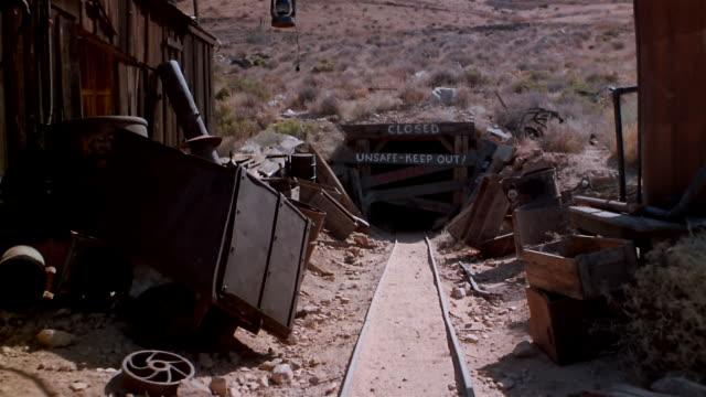 POV cart moving toward entrance of obsolete mine
