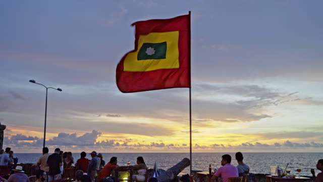 cartagena flag at sunset - sonnenuntergang stock videos & royalty-free footage