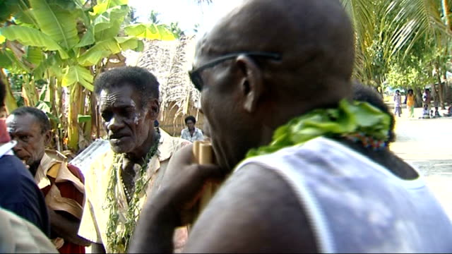 piul island male islanders playing pan pipes and other forms of wind instruments shells and gourds sot/ playing pipes and dancing in circle / three... - zucca legenaria video stock e b–roll