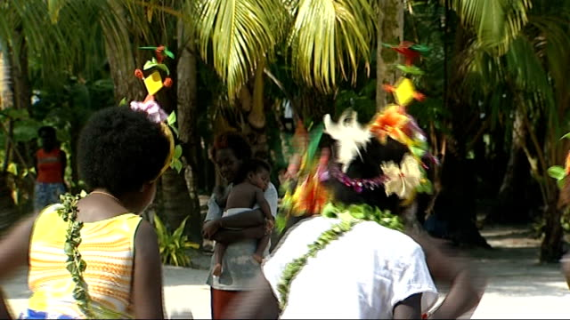 piul island papua new guinea carteret islands han island ext close ups drums being beaten by muscians sot / women dancers wearing ornate head bands... - sarong stock videos & royalty-free footage