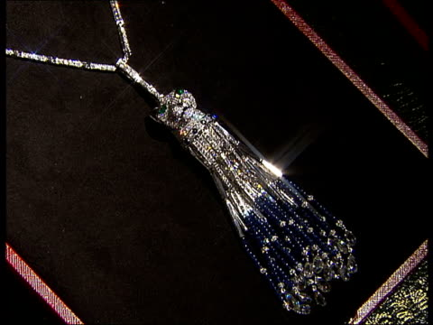 london int necklace from cartier panthere range made using sapphire beads and diamonds and featuring a panther's head with emerald green eyes /... - green eyes stock videos and b-roll footage