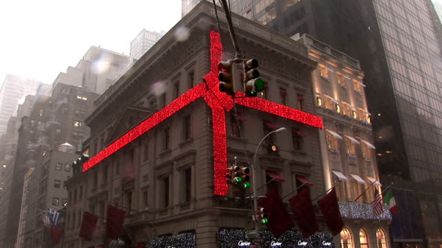 Cartier store decorated for Christmas on 5th Avenue as snow falls Manhattan