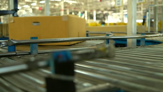 carton box moving on conveyor rollers. - packet stock videos and b-roll footage