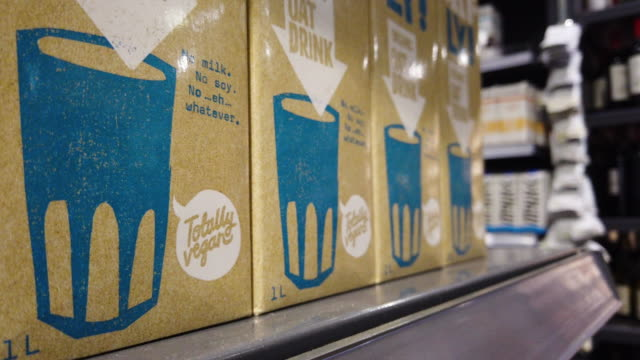 cartons of vegan dairyfree oat milk are seen in a branch of the planet organic healthfood store on january 03 2020 in london england veganuary a... - oat milk stock videos & royalty-free footage