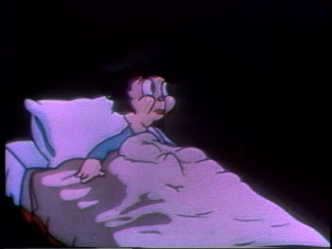 1935 montage cartoon boy laying in bed, cold wind blowing in window howls and flips his bedding down - 隠れる点の映像素材/bロール