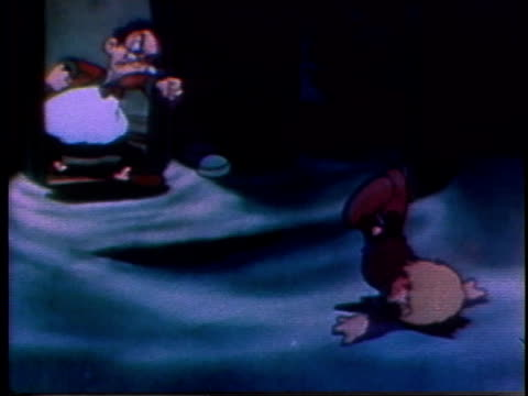 stockvideo's en b-roll-footage met 1935 ws cartoon man tossing boy out of the door and into the snow - woede