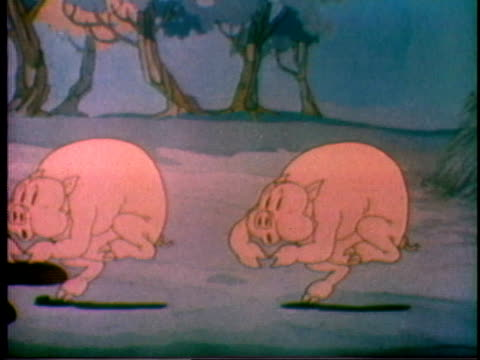 vídeos de stock e filmes b-roll de 1935 ws cartoon pigs dancing, then jumping into mud puddle up to their necks - porco