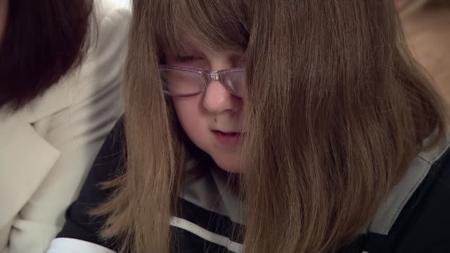 cartoonist inspired by daughter with spina bifida creates comic strip with disabled superheroes; england: hampshire: int various shots of emily white... - カトゥーニスト点の映像素材/bロール