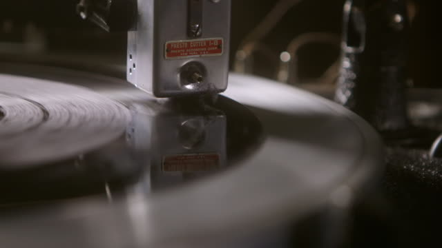 cu cartridge and stylus playing record on turntable / england, united kingdom - analog stock videos and b-roll footage