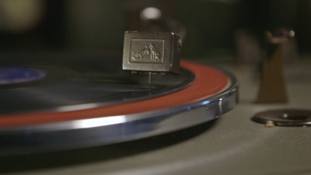 cu cartridge and stylus playing record on turntable / england, united kingdom - cartridge stock videos & royalty-free footage
