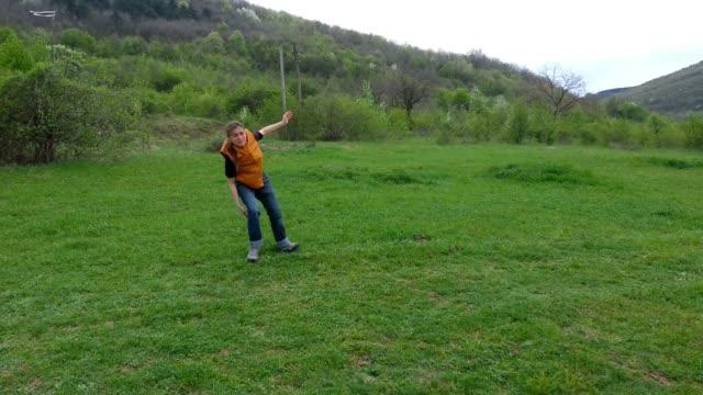 cartwheel. gymnastics outdoors. - cartwheel stock videos & royalty-free footage
