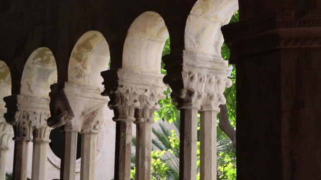 carved capitals and columns in the romanesque and gothic cloister of the franciscan monastery, dubrovnik - monastery stock videos & royalty-free footage