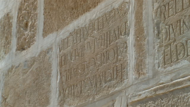 CU, PAN, carved Latin text in Great Mosque's wall, Kairouan, Tunisia