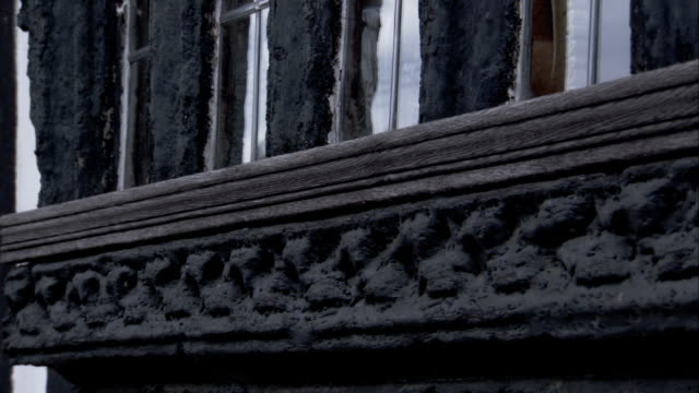 carved molding adorns the exterior of a medieval cottage. available in hd. - lavenham stock-videos und b-roll-filmmaterial