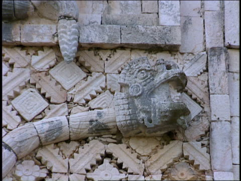 carved serpents decorate a wall at uxmal. - mayan stock videos & royalty-free footage