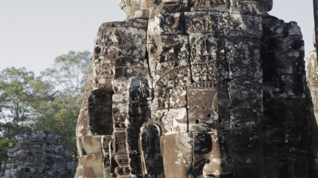 cu, td carved stone faces on bayon temple in angkor wat / siem reap, cambodia - temple body part stock videos and b-roll footage