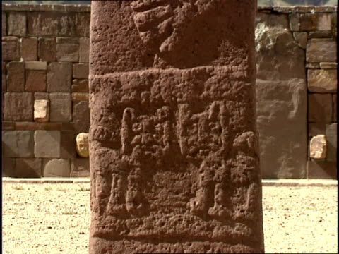 carved stone pillars are part of an ancient  temple in tiwanaku, bolivia. - obelisk stock videos & royalty-free footage