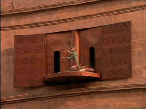 Carved wooden pied piper revolving clock display / Hamburg