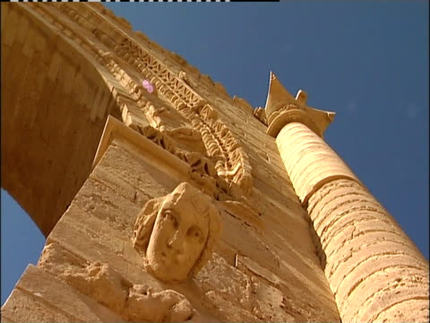 a carving adorns the side of an arch on an ancient temple in hatra, iraq. - column stock videos & royalty-free footage
