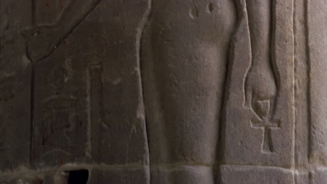 CU TU Carving in stone of female figure with cat head/ Egypt
