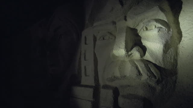 """carving in wall illuminated by torchlight in wunsdorf an abandoned soviet military garrison outside of berlin - """"bbc news"""" stock-videos und b-roll-filmmaterial"""