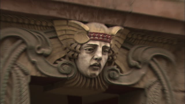 a carving of a human face adorns a doorway. - human face video stock e b–roll