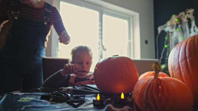 carving pumpkin for halloween - decoration stock videos & royalty-free footage