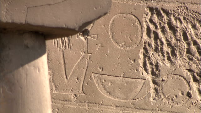 carvings decorate an ancient weathered wall. - weathered stock videos & royalty-free footage
