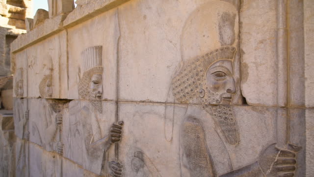 carvings from the city of persepolis - persepoli video stock e b–roll