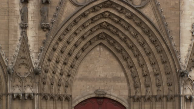 carvings on the exterior of the lyon cathedral draw the eye up to the rose window. - rose window stock videos and b-roll footage