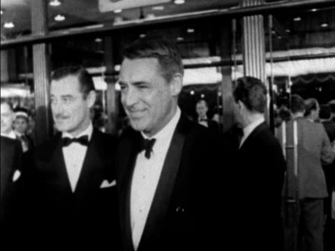 cary grant arrives at the leicester square theatre for the film premiere of once more with feeling. 1960. - actor stock videos & royalty-free footage