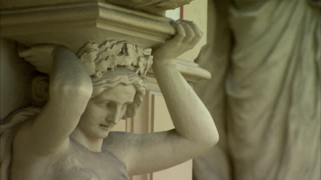 A caryatid decorates the facade of the Hofburg Palace in Austria. Available in HD.