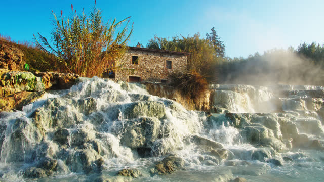 slo mo cascades at the saturnia hot springs - natural landmark stock videos & royalty-free footage