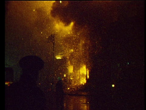 cascades of sparks fall from blazing british embassy set alight by protestors angry at bloody sunday shootings in londonderry firemen attempt to... - fire engine stock videos & royalty-free footage