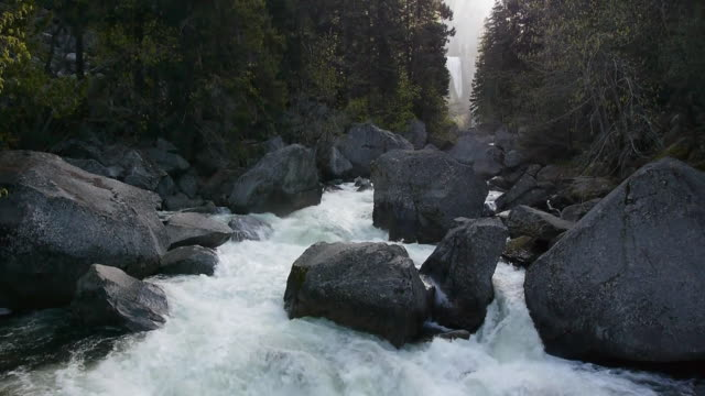 cascading merced river with vernal fall in background in yosemite national park, california - merced fluss stock-videos und b-roll-filmmaterial
