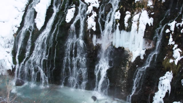 cascading waterfall in hokkaido during winter, high angle - kamikawa subprefecture stock videos and b-roll footage