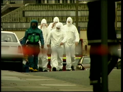 further briton infected lib liverpool man in decontamination suit leading along postal workers wearing white boilersuits who it was feared had come... - merseyside stock videos and b-roll footage