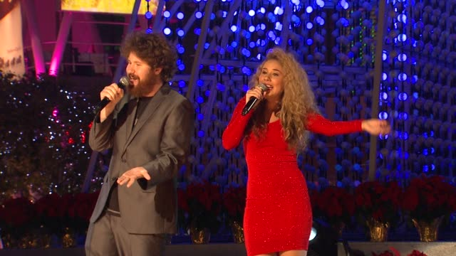 Casey Abrams Haley Reinhart at 4th Annual Holiday Tree Lighting At LA LIVE Opening Of LA Kings Holiday Ice in Los Angeles CA