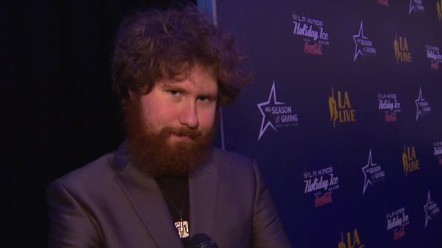 Casey Abrams on performing at the LA Live Holiday Tree Lighting what the song he sang means to him personally his favorite holiday memory why it's...