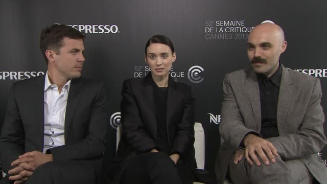 casey affleck, david lowery, rooney mara on doing a sequel of the girl with the dragon tattoo at 'ain't them bodies saints' interview at nespresso... - tattoo stock videos & royalty-free footage