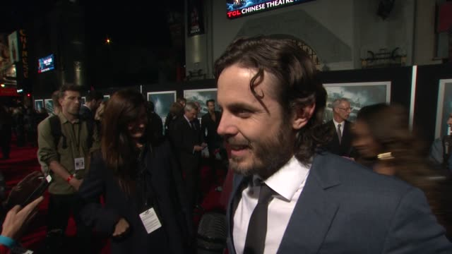 interview casey affleck on what it means to have his movie premiere at such an iconic theater on if he's excited to see it in imax and on if the fact... - tcl chinese theater stock-videos und b-roll-filmmaterial