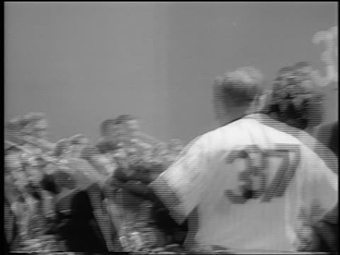 vídeos de stock e filmes b-roll de casey stengel conducting guy lombardo's band on baseball field / newsreel - camisola de basebol