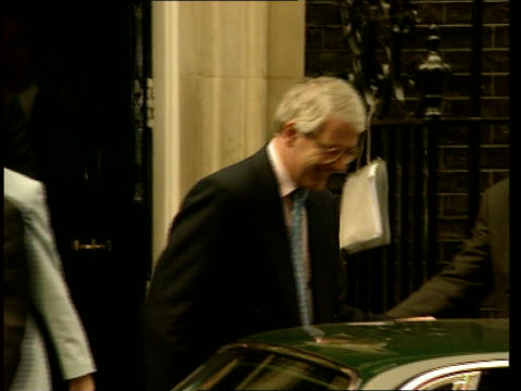 Interim report released ITN ENGLAND London PM John Major MP from No 10 and into car Car away and thru gates of Houses of Parliament